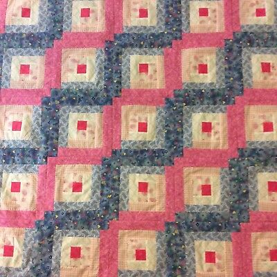 Handmade pink and blue Log Cabin baby quilt, flannel back
