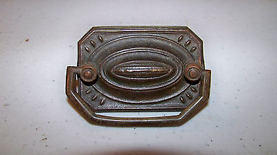 Group of Eight Antique Stamped Brass Backplates with Seven Brass Pulls