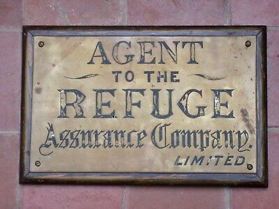 Old Brass  Assurance Sign . On  Wooden Frame