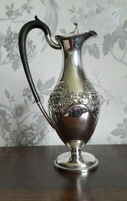 A Beautiful Antique Silver Plated Wine Ewer with Embossed Pattern by Fenton Bros