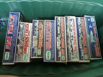 NEW Hess in box lot of 8 firetrucks, helicopter, truck, airplane, space shuttle