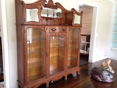 Beautiful antique oak library / display case. Beveled glass mirrors.