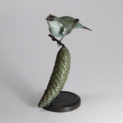 Limited edition solid bronze bird sculpture by artist Bryan Hanlon