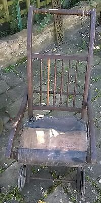 Fold up mahogany antique chair on wheels. No arms. Edwardian.Collectors item.