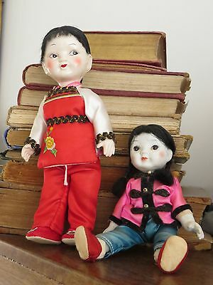 Two  vintage Asian dolls