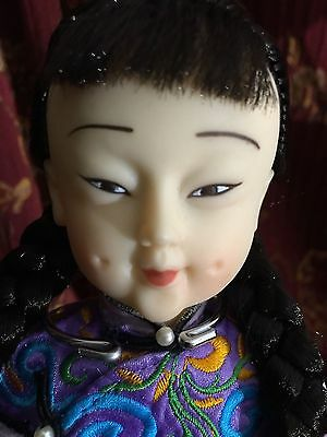 Chinese Rubber Doll In Embroidered Silk Clothing
