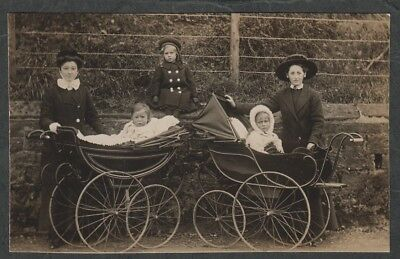e373)       VINTAGE REAL PHOTO POSTCARD: CHILDREN AND LOVELY OLD PRAMS  1911