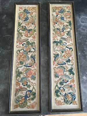 A pair of oriental embroidered panels