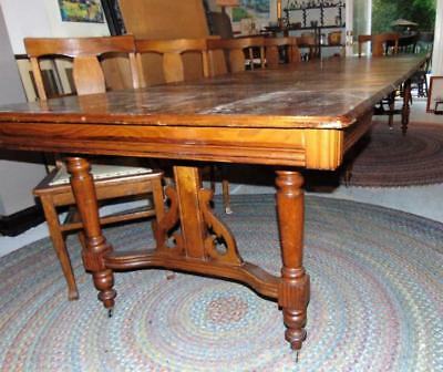 Oak 6 legged dining table, w/10 leaves, and 6 t-back chairs. Lot 284