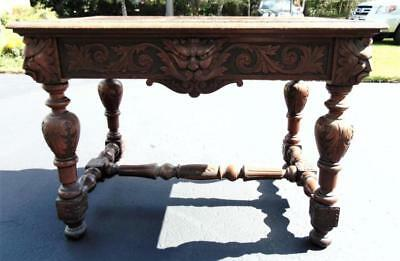 R.J. Horner style library table, griffin and north wind carved, singl... Lot 202