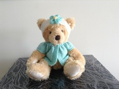hand knitted teddy bear clothes to fit a 30cm teddy. jacket and headband