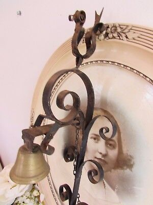 French long and curly metal pull chain door bell.  Country cottage chic!