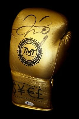 New* Floyd Mayweather Hand Signed Gold TMT Boxing Glove.Beckett Authentication