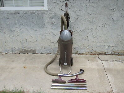 Vtg antique vacuum cleaner Sears Kenmore upright with accessories.