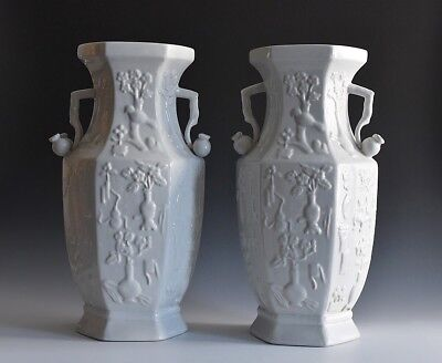 A Pair Of Large Chinese Dehua Glazed Molded Vases