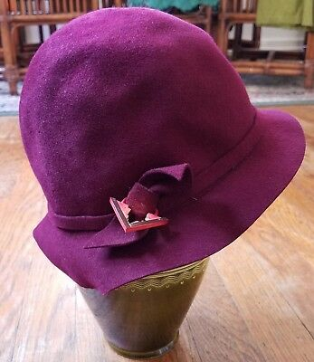 1920s Burgundy Wool Felt Flapper Cloche Hat with Side Bows and Celluloid Pendant