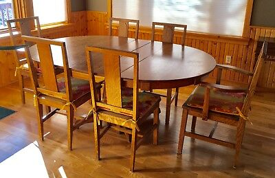 Antique Arts and Craft dining table with 3 leaves and 6 chairs.