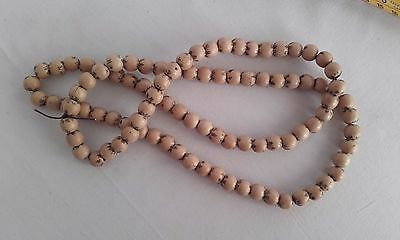 Collection of vintage Japanese inscribed symbal blond wooden beads