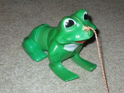 Vintage FROG SLINKY PULL TOY with plastic spring; hopping movement works well