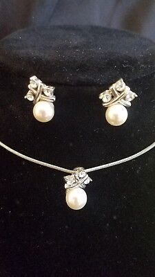 Beautiful simulated pearls and a silver setting with cubic zirconium set by Avon