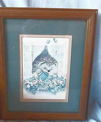 Whimsical Hedgehog Watering Flowers Framed Print