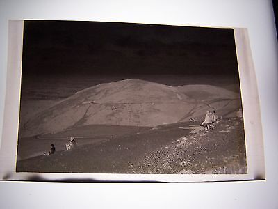 Vintage Negative People sitting on top Mountain looking at View bench