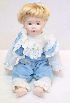 Sitting Porcelain Doll blue eyes, blonde hair in blue overalls NJSF #11070