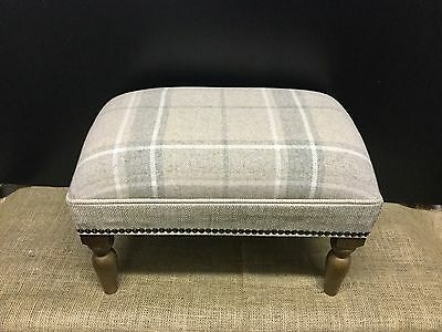 Footstool upholstered in a Laura Ashley highland check natural