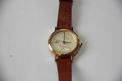 Vintage Micky Mouse Lorus Quartz Gold face, Ladies with light brown band.