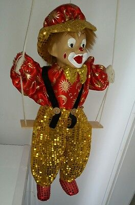 Vintage Clown Doll On Wooden Swing Hangs 2 feet tall Red Gold Porcelain Face