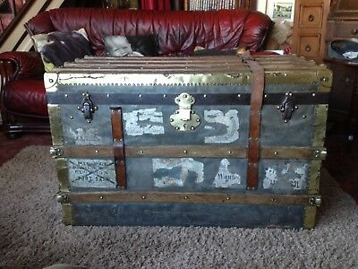 Antique Large Well Traveled Steamer Trunk On Wheels