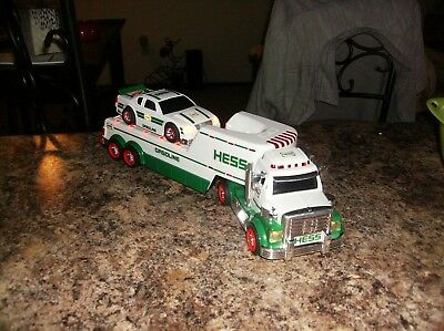 HESS toy flat bed semi truck with race car 2011