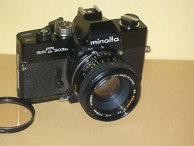 Black Minolta SRT303b with 1.7 PF 50mm lens & checks out working