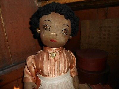 Antique Black Bottle doll great detail and clothing.