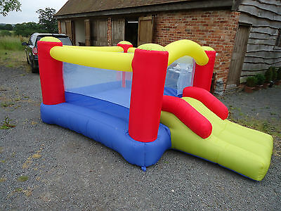 Bouncy Castle With Slide/ Red/blue/yellow  Excellent Condition With Safety Net