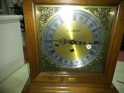 Howard Miller mantel clock, with Bayer emblem from Miles laboratory.