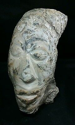 "Fossilized Oyster Shell Carving - Indonesian warrior face 10"" long"