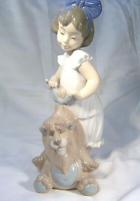 LLADRO/NAO A Pretty Girl  tying the bow on her toy Lions mane