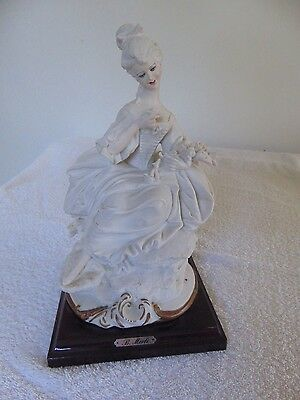 Capodimonte Porcelain Figurine Lady With Flowers. Bruno Merli. 1982 Florence.