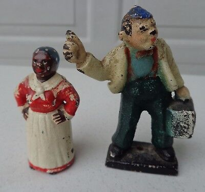 Two Antique Cast Iron Paperweights Mammy And College Man Hitch Hiking W Suitcase