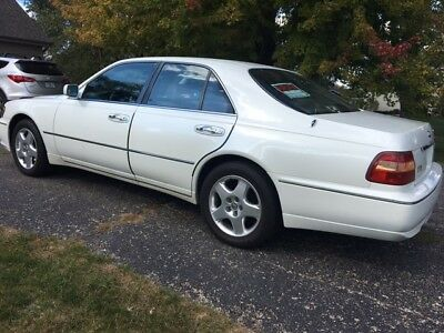 1999 Infiniti Q45 Leather Infiniti Q45t white with tan interior and fully loaded. AT NO RESERVE
