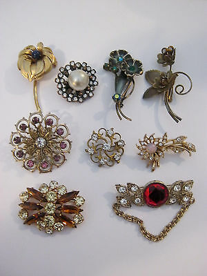 Brooches, small lot of 9 vintage goldtone brooches, lots of rhinestones