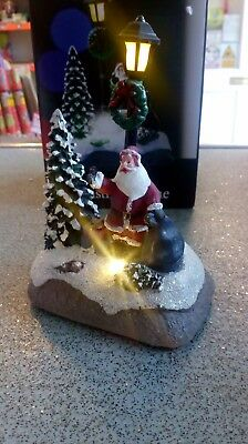 Battery operated light up Christmas scene. Santa with tree and lamp post.