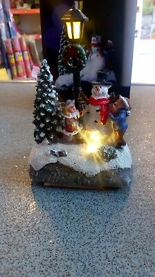 Battery operated light up Christmas scene. Snowman with tree and lamp post.