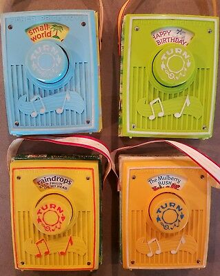 Vintage 1970 Fisher Price Music Box Pocket Radio - 4 total with different songs