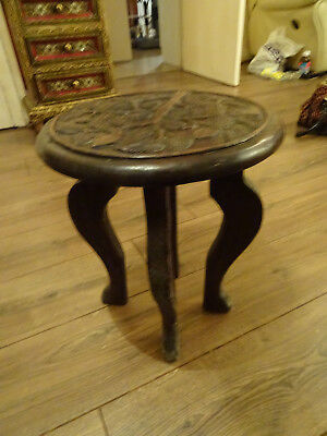 unusual antique small side table carved with a religious theme