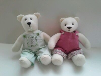 A pair of cuddly white Bears.