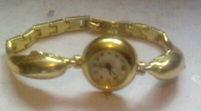 Gold coloured dolphin watch