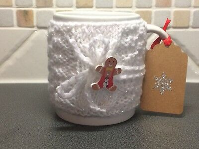 Hand Knitted White Sparkle Mug Cosy With Cute Gingerbread Man Button