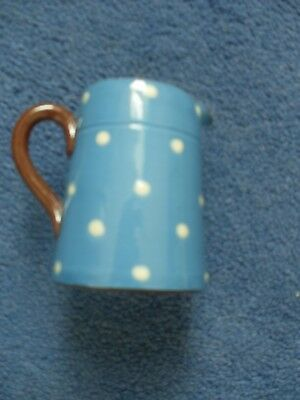 Vintage Royal watcombe cream jug Blue with white spots brown handle and edge.